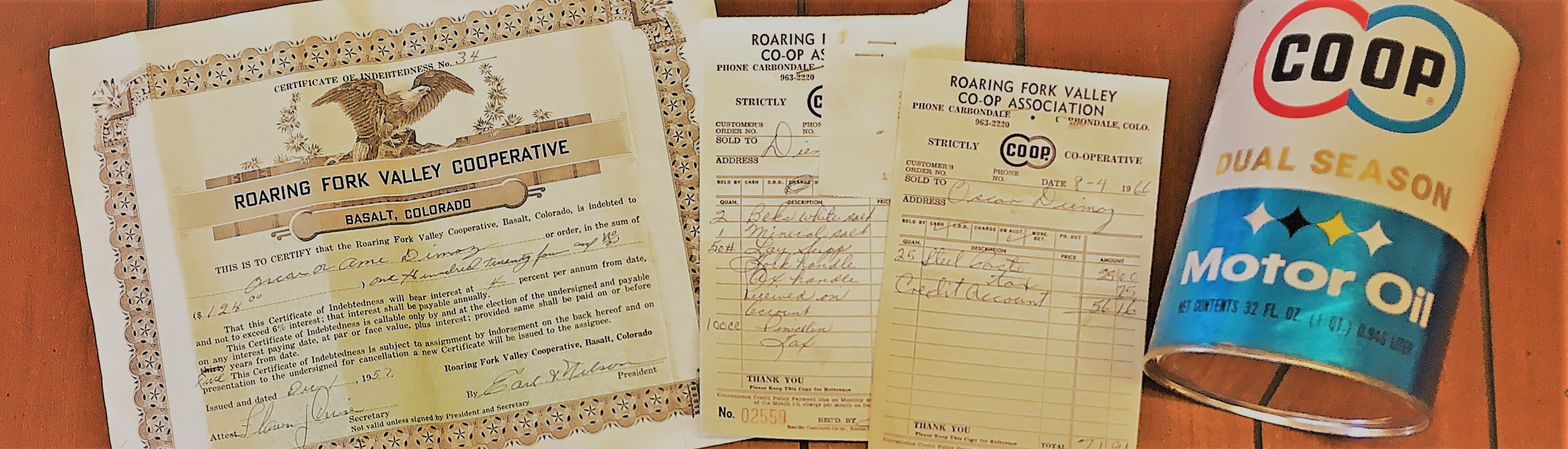 Co-op documents from the 1950s and 1960s and a can of Co-op motor oil